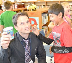 Principal Bobby Murphy getting face painted